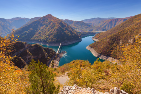 Colorful panorama to beautiful nature in autumn ambience at idyllic morning in canyon of river Piva, Montenegro.