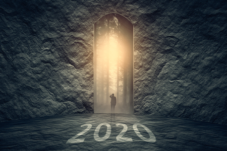 Successful way out and problem solving as silhouette of a lone man to find solution in upcoming 2020 new year. Business and success concept. Stock fotó