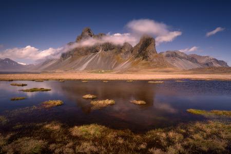 Iceland landscape photo of Eystrahorn impressive mountains at beautiful idyllic day.