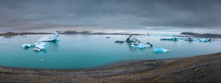 Popular tourist attraction Jokulsarlon as large glacial lake in southeast Iceland at cloudy morning