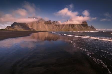Iceland landscape photo of impressive mountains at Stokksnes peninsula with black beach at idyllic morning.