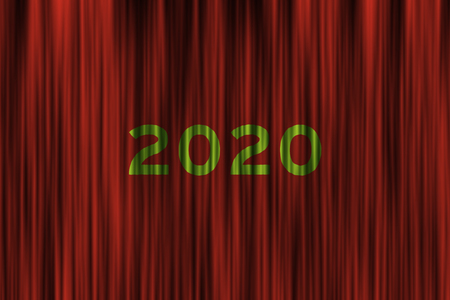 Red stage curtain with 2020 written on surface as complimentary colors.