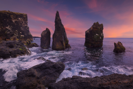 Iceland landscape photo of Reykjanesta cliffs at moody sunset with powerful waves. Stock fotó