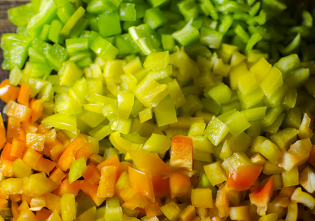mincing: Red, green and yellow pepper dices