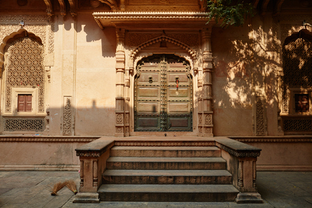 Wooden gate of an ancient temple in Vrindavan, India Stock Photo