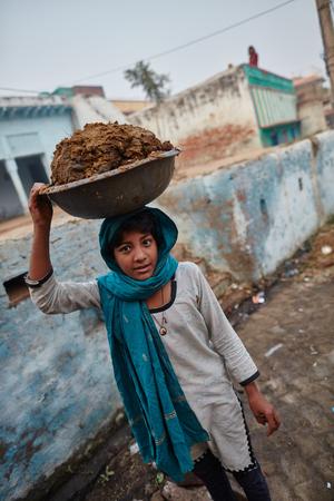 Vrindavan, 22 October 2016: Two women carrying baskets, in Vrindavan, UP