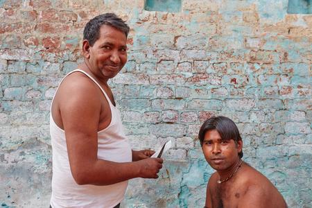 Vrindavan, 22 October 2016: Barber working on the street, in Vrindavan, UP