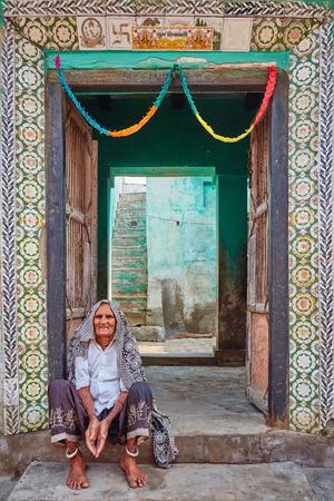 Vrindavan, 22 October 2016: Indian elderly woman sitting on the stairs, in Vrindavan, UP Editorial