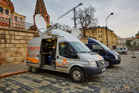 Moscow - 10.04.2017: Two broadcast vehicles parking near Kremlin in Moscow