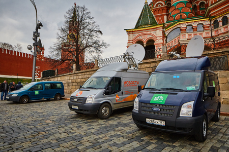 power cables: Moscow - 10.04.2017: Two broadcast vehicles parking near Kremlin in Moscow