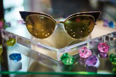 Vintage colorful sunglasses on a display Stock Photo