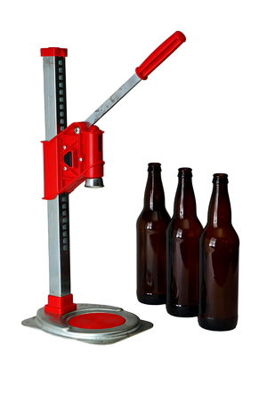 capping: Bottle Cap Press and Bottles for Homebrew Beer Stock Photo