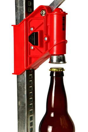 Bottle Cap Press with Bottle for Homebrew Beer, Close Up Stock Photo