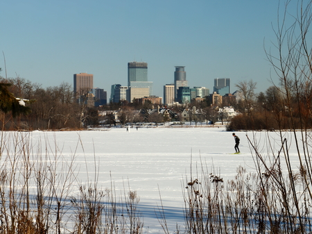 water skiers: Skiing under the Minneapolis Skyline on Lake of the Isles