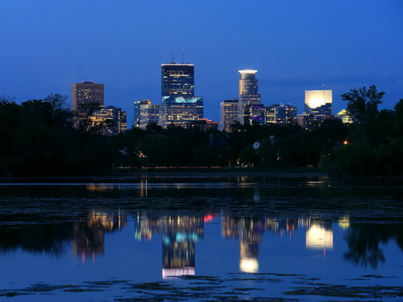 Minneapolis Skyline Reflecting in Lake of the Isles at Night