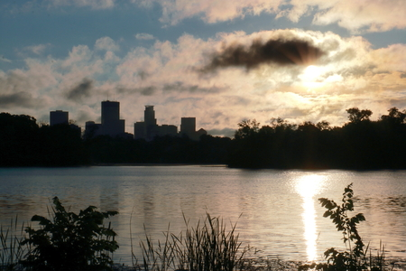 Sunrise over Lake of the Isles with Minneapolis Skyline in Silhouette Stock Photo
