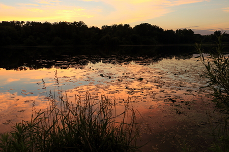 Colorful Sky Reflects off Wirth Lake at Sunset in Minneapolis