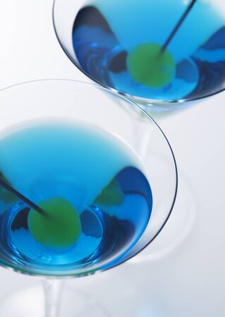 Blue martini and olives