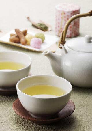 Cup of lemon tea, pot and breakfast