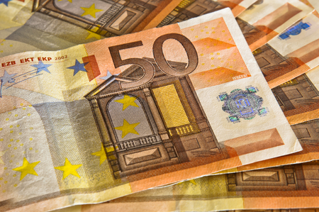 gain: A 50 euro banknote on top of other banknotes to indicate gain in business