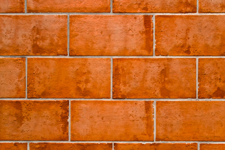 A background of a brick floor in terracotta photo