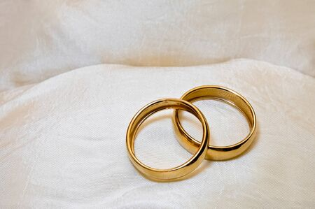 bonbonniere: Close up of two wedding rings as a symbol of marriage