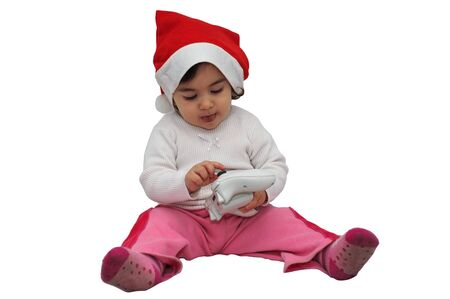 joypad: Child who observes the joy pad with Christmas hat Stock Photo