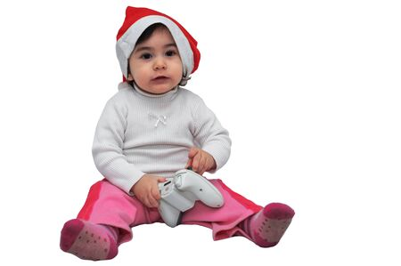 Girl with Christmas hat playing a video game photo