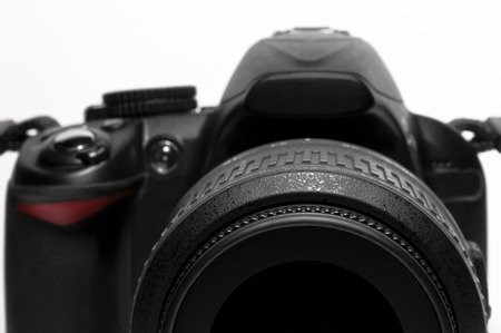 dslr camera: DSLR camera isolated as a photo concept Stock Photo
