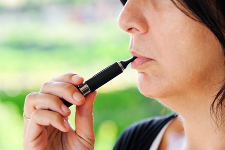 steam mouth: Detail of a smoker of Electronic Cigarette Stock Photo