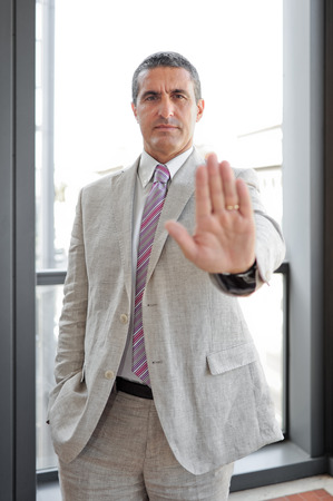 alt: Businessman with sign alt in outdoor as business concept