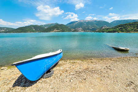 tora: Wide shot of the different boats on Lake Turano in Italy