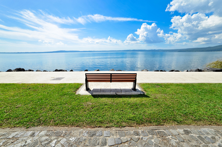 foreshortening: Panoramic outdoor bench of the Lake Bracciano in Italy