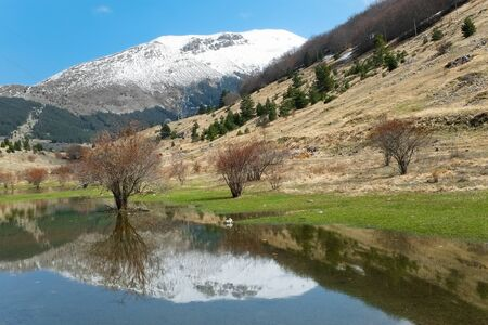 glimpse: Glimpse of a high mountain landscape during the melting of snow Stock Photo