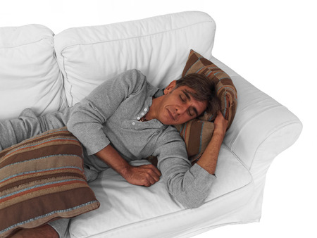 blissfully: Close up of a man sleeping on the couch as the concept of relaxation Stock Photo