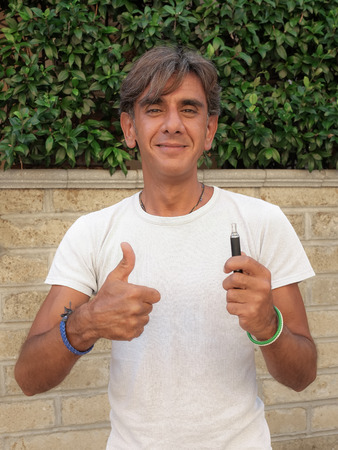 e cig: Closeup of a satisfied smoker who chose the electronic cigarette