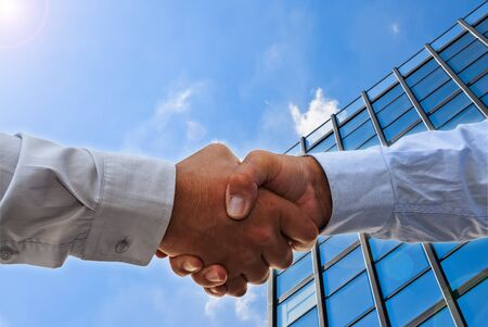glass building: Handshake on glass building as a concept of collaboration in business Stock Photo