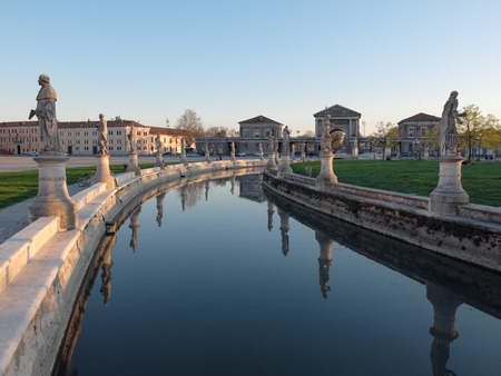 glimpse: Glimpse at sunset of Prato della Valle in Padua with its statues and the characteristic circular lake