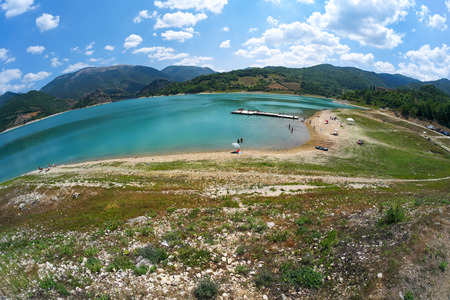 bather: Panoramic view with fisheye effect of Lake Turano in Italy during the summer Stock Photo
