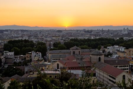 Overview from above on Rome in Italy at sunrise Stock Photo