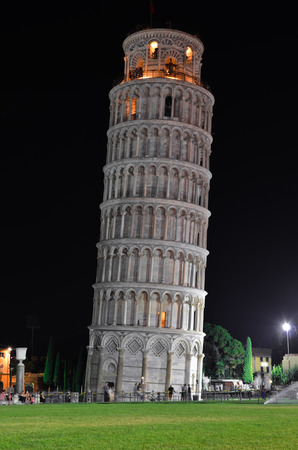 PISA  August 19, 2011  Night glimpse of the Tower of Pisa in Italy with tourists.