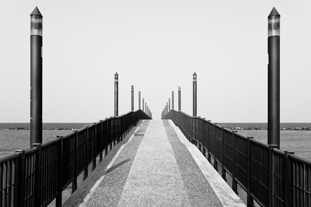 Black and white version of the main jetty of Francavilla al Mare in Italy Stock Photo