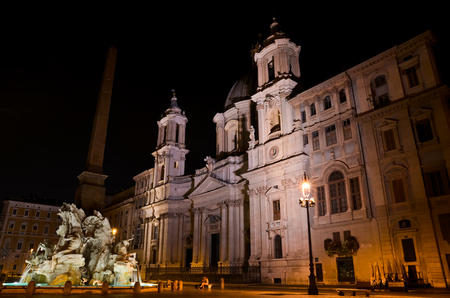 ROME  August 27, 2011  Night version of Navona Square in Rome, with church and fountain illuminated, in Italy.