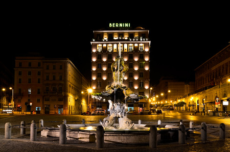 ROME  August 27, 2011  Night version of Triton Fountain in Rome, appropriately illuminated by the headlights, in Italy. Editorial