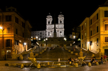 ROME  August 27, 2011  Night version of Piazza di Spagna in Rome, with church and fountain illuminated, in Italy.