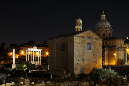ROME  August 18, 2012  Night version of Imperial Forums in Rome, with church and temple illuminated, in Italy.