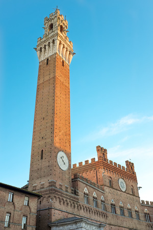 antiques: Day View of the Torre del Mangia in Siena, a historic monument of Tuscany in Italy. Stock Photo