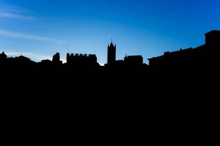 Black silhouette of the palaces of a city with the background of the blue sky Stockfoto