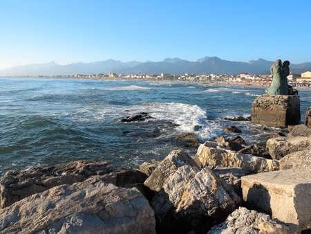 Summer view of the coast of Viareggio in Italy, with the monument L'attesa.