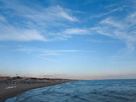 Summer view of the beach of Forte dei Marmi in Italy at dusk.